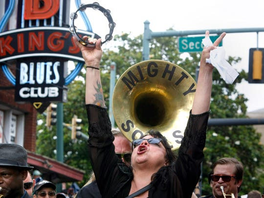 Memphis blues singer Barbara Blue wails at the head of the procession leading the hearse carrying the remains of B.B. King down Beale Street Wednesday, May 27, 2015, in Memphis, Tenn.