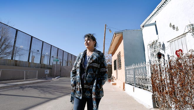 Chihuahuita Neighborhood Association President Manny's Silva Rodriguez looks out at the current wall separating her neighborhood from Juarez. Rodriguez said the wall President Donald Trump wants to build still has a long way to go before its approved but says she feels safe in her neighborhood where her family has lived for three generations.