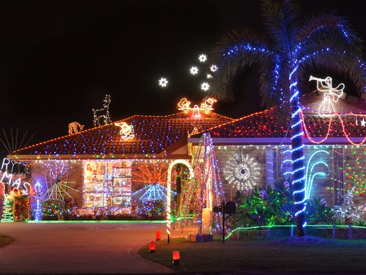 Exterior evening shot of Christmas decorated house in Southern Hemisphere