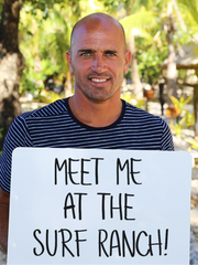 World champion surfer Kelly Slater grew up in Cocoa Beach. Here he's shown holding a sign to promote his surf ranch.