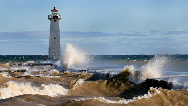 Heavy waves pound the shore at Sodus Point in Wayne County.