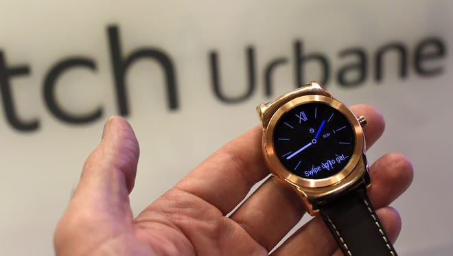 A person holds the LG Watch Urbane LTE during its presentation in the 2014 Mobile World Congress (MWC) in Barcelona on March 1, 2015.