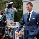 Tom Brady, who didn't have to serve a four-game suspension over DeflateGate last season, when this photo was taken, now faces that punishment.