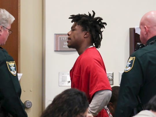 Terrance Moore, a former standout football player for Fort Myers High School exits a courtroom at the Lee County Courthouse on Monday 11/28/2016. He faces nine felony charges and has descended into alleged criminal activity. He was shot at Club Blu over the summer, then was arrested Oct. 30 and charged with 9 crimes, allegedly leading law enforcement on a 10-mile, 100-mile-per-hour car chase after, according to the police report, shooting several times into two houses on Market Street in Fort Myers.