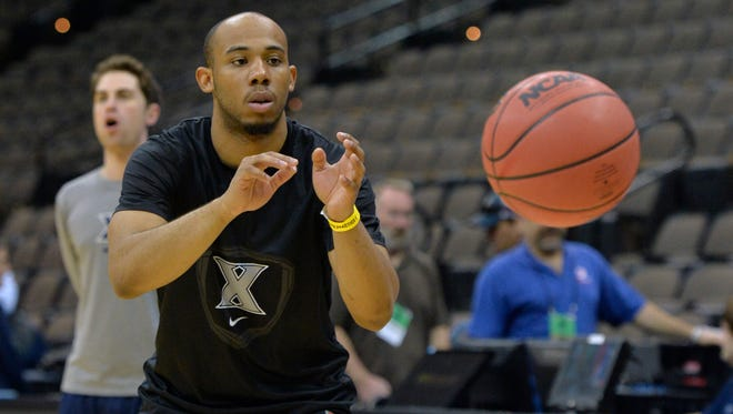 Xavier Musketeers guard Myles Davis reaches for a pass during practice before the second round  of the 2015 NCAA Tournament at Jacksonville Veteran Memorial Arena.