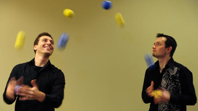 Jacob Weiss and Ted Joblin are part of the Playing By Air juggling troupe.