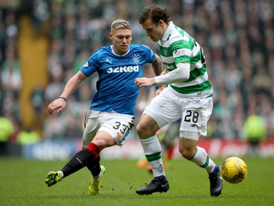 Celtic's Erik Sviatchenko, right, and Rangers' Martyn Waghorn battle for the ball during the Scottish Premiership soccer match at Celtic Park, Glasgow, Sunday March 12, 2017. (Jane Barlow/PA via AP)