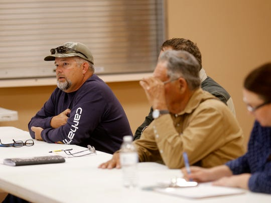 At left, Andrew Dean, chairman of the Bloomfield Irrigation District Ditch board, talks on Monday during a meeting at the Bloomfield Multicultural Center.