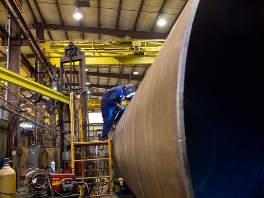 A welder works in the Process Equipment & Service Co.,
