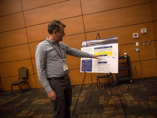 Office of Surface Mining Reclamation Enforcement Western Office Field Manager Marcelo Calle talks during a scoping meeting Thursday at the Farmington Civic Center.