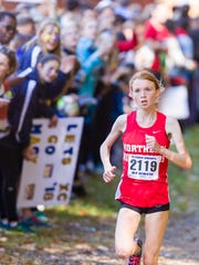 Monica Hebner of Northern Highlands leads the field to the finish line in the girls varsity race during the Bergen County cross country meet of champions at Darlington County Park.