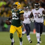 Green Bay Packers cornerback Casey Hayward (29) returns an interception against the Chicago Bears.