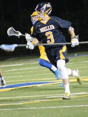 Moeller defender Jack Toomb is on the run for the Crusaders against Mariemont April 22.