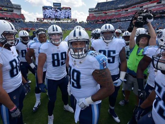 Tennessee Titans defensive end Jurrell Casey (99) fires