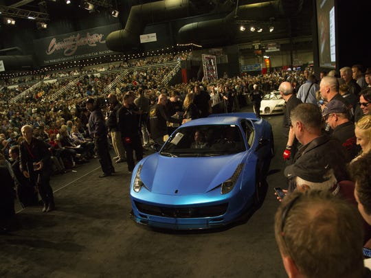 Justin Bieber's 2011 Ferrari 458 Italia enters the auction floor at Barrett-Jackson on Jan. 21, 2017, at WestWorld in Scottsdale.