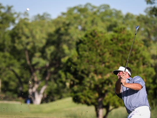 Nathan Pomroy hits the ball at second hole during the