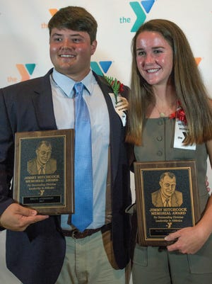 Brian Anderson, left, of Montgomery Catholic High School, and Mary Conley Teel, right, of Trinity School, are the 2017 Jimmy Hitchcock Award winners. They are shown at the award dinner at Frazer United Methodist Church in Montgomery, Ala., on Thursday May 4, 2017.