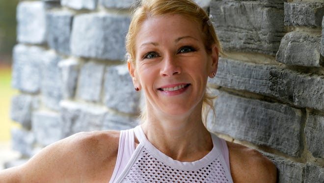 Christine Conti of Brick is fighting back against rheumatoid arthritis by competing in Ironman Lake Placid, a grueling multi-sport endurance race.