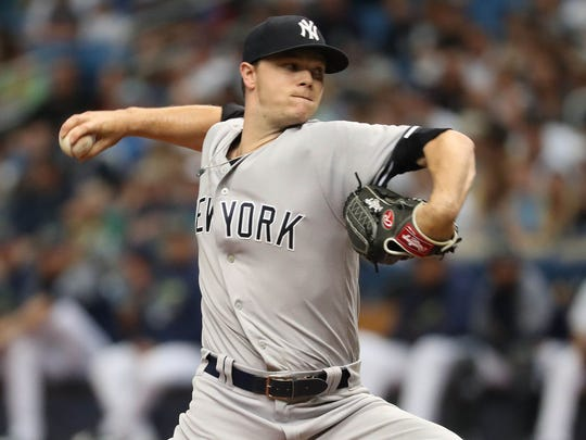 Jun 23, 2018; St. Petersburg, FL, USA; New York Yankees starting pitcher Sonny Gray (55) throws a pitch during the first inning against the Tampa Bay Rays at Tropicana Field.