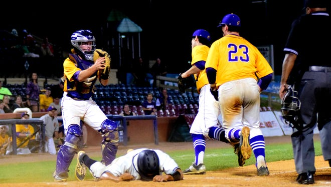 """Campbell County catcher Matt Reynolds shows the ball in his glove for the umpire while Hazard High runner Cole Ratliff is buried face down in the dirt knowing the inevitable call of """"Out at Home."""""""