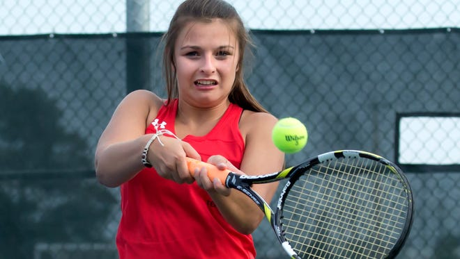 Lourdes Academy's Maria Tushar back hands a return Tuesday playing in a doubles match at U.W. Oshkosh tennis courts August 29, 2017.