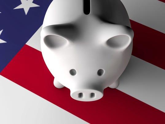 Piggy Bank Over American Flag