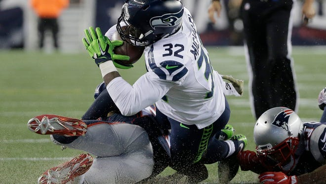 New England Patriots defenders tackle Seattle Seahawks running back Christine Michael (32) during the first half Sunday, Nov. 13, 2016, in Foxborough, Mass.