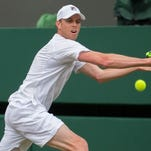 Sam Querrey (USA) in action during his match against Novak Djokovic (SRB) during Wimbledon on July 3.