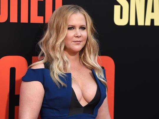 Amy Schumer arrives at the Los Angeles premiere of 'Snatched' at the Regency Village Theatre.