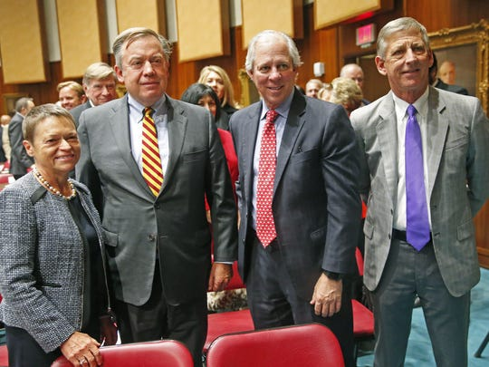(From left) Norther Arizona University President Rita Cheng, Arizona State University President Michael Crow, University of Arizona President Robert Robbins and Grand Canyon University President Brian Mueller pose for a photo after Gov. Doug Ducey's State of the State speech at the Capitol in Phoenix on Jan. 8, 2018.