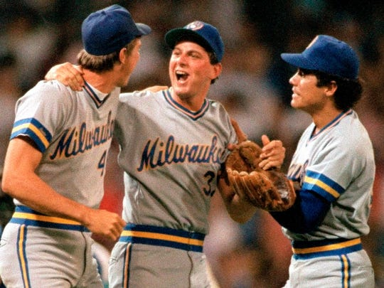 Milwaukee Brewers pitcher Dan Plesac, center, is congratulated by teammates Mike Birkbeck, left, and Juan Nieves after their 5-4 win over the Chicago White Sox in Chicago, Ill., on April 20, 1987.