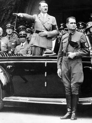 1938 file photo show Adolf Hitler during a parade in Berlin, Germany.