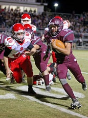 Stuarts Draft's Xzavier Gunn runs the ball for the first touch down of the game in the first quarter on Friday, Nov. 4, 2016 as the Cougers play Riverheads at Stuarts Draft.