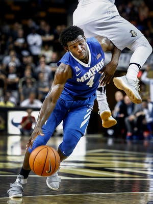University of Memphis guard Keon Clergeot (left) is the latest Tigers player to announce he will transfer from the program.