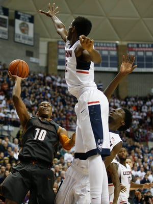 Texas Longhorns forward Jonathan Holmes (10) shoots against the Connecticut Huskies in the second half at Harry A. Gampel Pavilion.
