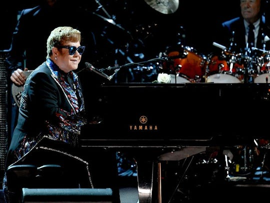 Recording artist Sir Elton John performs onstage during