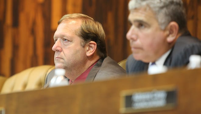 Clarkstown town Supervisor George Hoehmann, left, listens to a resident during a Town Board meeting in 2016.