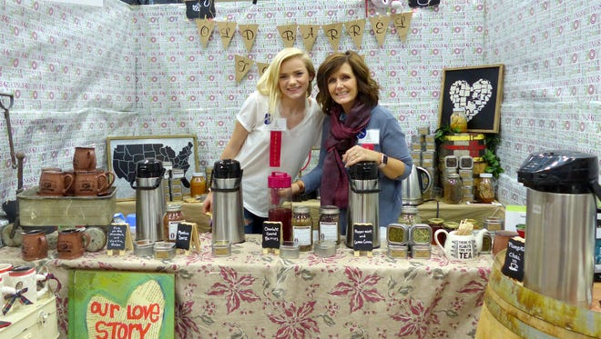Morgan Johnson and Dana Huffmon show off products from the Old Barrel Tea Company.