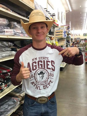 NMSU rodeo team's new coach, Logan Corbett, in his Aggie gear after he found that he had officially received the job.