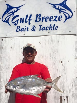 Local angler Ray Werhan with a 4.84 pound pompano he caught last year during the Gulf Breeze Bait & Tackle Pompano Tournament.