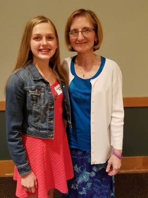 West Middle School eighth-grader Lindsay Ripple (left) won $1,000 for her essay about Seedlings founder Debra Bonde (right).