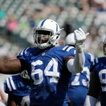 Though he saw action at defensive end in just five games last year, Earl Okine is going to get a long hard look at outside linebacker this season for the Colts.