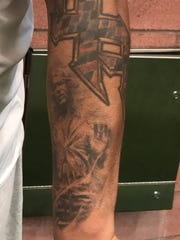 NY Giants defensive tackle A.J. Francis shows his tattoo of Han Solo from Star Wars during an interview at training camp in East Rutherford, NJ.