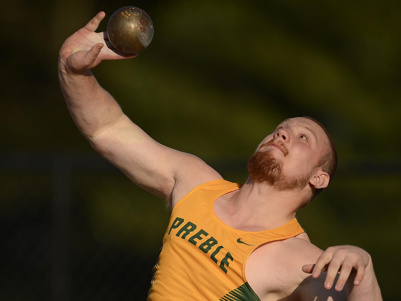 Green Bay Preble's Ryan Ray makes a throw while competing in the Division 1 shot put at the WIAA state track and field meet. Ray took third in the event.