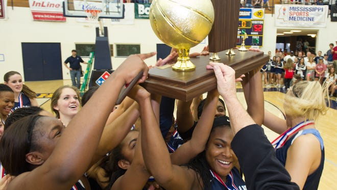 Jackson Academy hoists the MAIS Overall championship trophy after winning it for the second-straight season on Saturday, beating Kirk Academy.