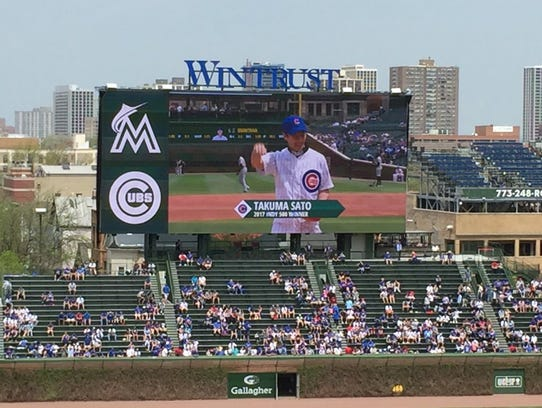 Takuma Sato threw out the first pitch at Wrigley Field