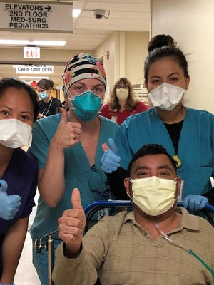 Arturo Leon-Ortiz, 41, seen here with his nursing staff, was released from Western Plains Medical Complex on May 22 after a 24-day battle with COVID-19. Of the 24 days in the hospital, Leon-Ortiz spent 20 of them in the ICU.