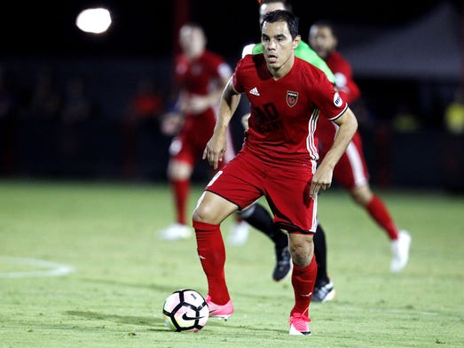 Phoenix Rising FC's Omar Bravo (9) dribbles against