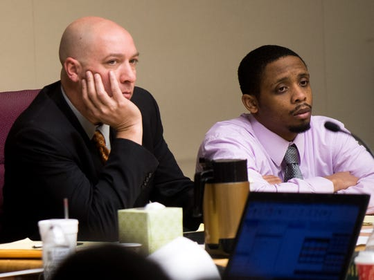 Defense attorney Kit Rodgers, left, and Richard Gregory Williams III, right, listen as opening statements are made in the Zaevion Dobson slaying trial at Knox County Criminal Court on Tuesday, Dec. 5, 2017.