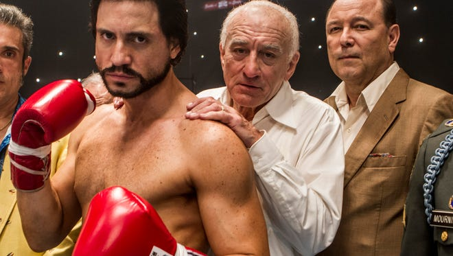 "This image released by The Weinstein Company shows Edgar Ramirez, from left, Robert De Niro, and Ruben Blades in a scene from, ""Hands of Stone."" (Rico Torres/The Weinstein Company via AP)"
